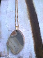 Sliced #agate pendant in blue-grey tones on a goldplated long chain