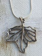 Sterling silver leaf pendant on a silver long chain