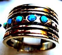 Israeli opal spin ring silver and gold jewelry