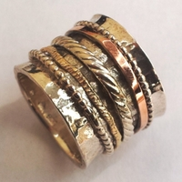 Israeli ring silver gold spinning bands