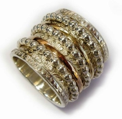 Man's ring spinner silver and gold Bagues Anillos
