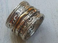 Modern Ring spinner spinning bands on a sterling silver base