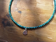 Necklace delicate small turquoises beads with pomegranate silver charm