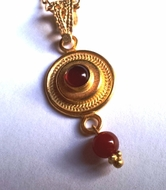 Necklace sterling silver gold plated pendant set with a coral stone