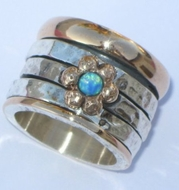 Opal sterling silver and gold spinner ring flower motif