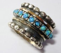 Opals silver and gold spinner ring