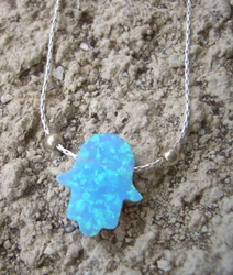 Pretty Israeli typical opal blue hamsa on a silver chain
