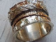 Ring spinner silver gold braided