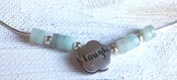 "Pretty necklace ""laugh"" charm with  gemstones"