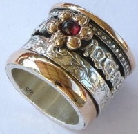 Silver and gold spinner rings set with garnets