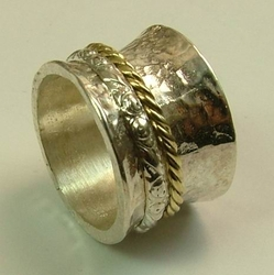 Silver and gold Israeli ring spinner