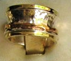 Silver and gold Israeli spinning ring about 1.5 width