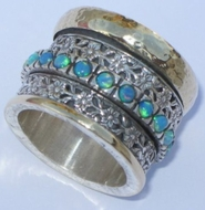 Silver and gold set with opals spinning ring