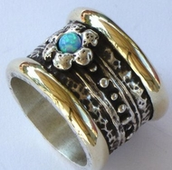 Silver and gold spinner ring. Silver flower set with opal stone.