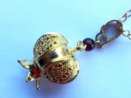 Silver necklace gold plated pomegranate garnet pendant