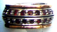 Spinner band garnets silver gold ring