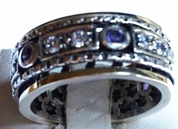 Spinner ring set with  cz and amethyst
