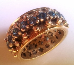 Spinner ring silver and gold set with blue topaz