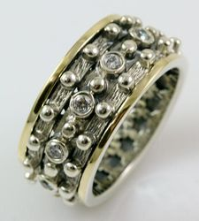 Sterling silver spinner ring set CZ stones