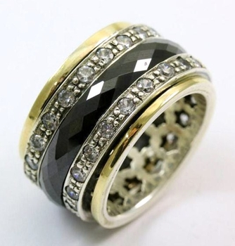 Israeli jewelry spinner ring with ceramic band and zircons
