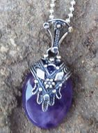 Silver pendant hamsa on Amethyst gemstone
