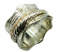 Spinning curved ring in a two tone designer ring silver and gold
