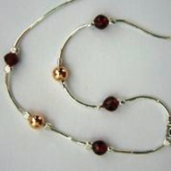 Sterling silver necklace set with gemstones