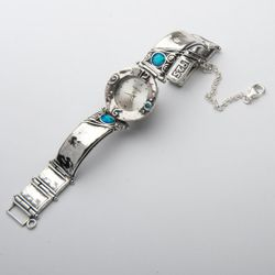Sterling silver watch set with opals