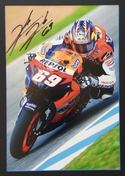 <big><Center>Nicky Hayden Signed Large Photo<br>This large display of the 2006 MotoGP champion is signed,<br> with his famous racing number 69.</big></center>