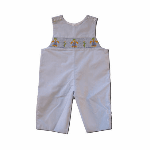 Petit Bebe Scaredy Crow Boys Long Jon Jon that is light blue with scare crow in the smocking. Matches the Girls.