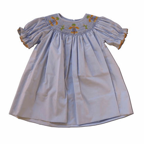 Petit Bebe Scaredy Crow Short sleeve bishop light blue dress with scare crow in the smocking. Exquisite.