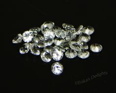 4mm Round Natural White / Clear Topaz  1pc