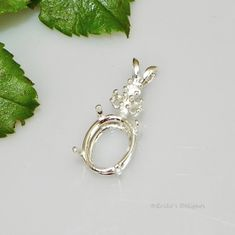 7x5 Oval with 3 Accents Sterling Silver Pre-Notched Pendant Setting