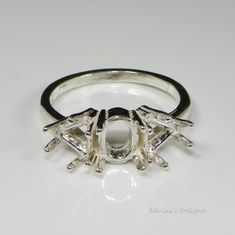 9x7 Oval with 6mm Trillion Accents Sterling Silver Ring Setting
