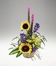 A basket arrangement of bright flowers.