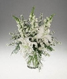 All white arrangement in clear glass.