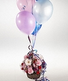 An arrangement of flowers and balloons.