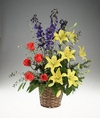 Bright flowers arranged in a basket.