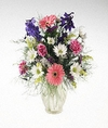 Mixed summery flowers in frosted vase.