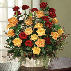 Red, Orange Roses and Red Huckleberry Arrangement