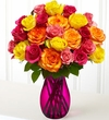 Two Dozen Multicolored Roses with Pink Vase