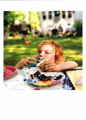 Child eating a cupcake
