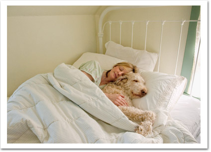 Lady in Bed Asleep with Dog