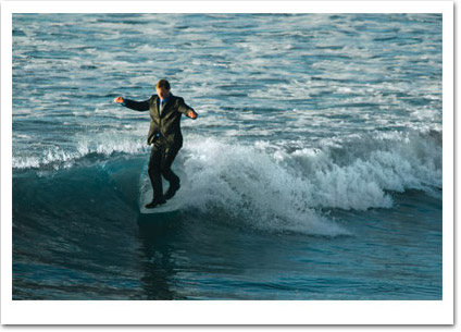 Man Surfing in Suit