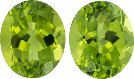 Deal 11.06 carat Peridot Matching Pair in Oval Cut, 12.0 x 10.0 mm German Cuts