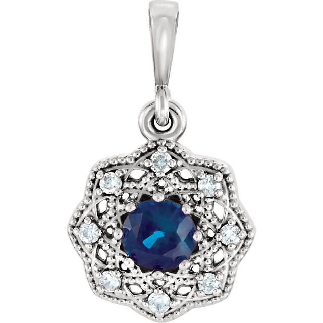 Stunning 14 Karat White Gold Blue Sapphire & .06 Carat Total Weight Diamond Halo-Style Pendant