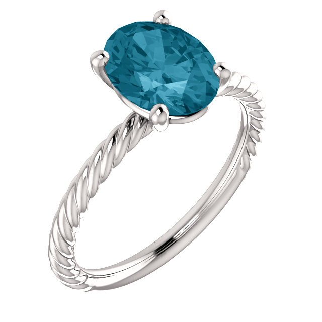 Wonderful 14 Karat White Gold Oval Genuine London Blue Topaz Ring