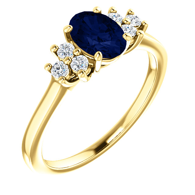 14 Karat Yellow Gold Blue Sapphire  & 0.20 Carat Diamond Ring