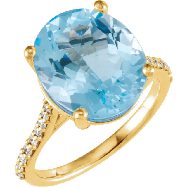 Pleasing 14 Karat Yellow Gold Oval Genuine Sky Blue Topaz & 1/4 Carat Total Weight Diamond Ring