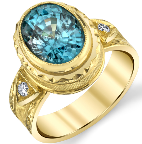 Amazing Hand Made Bezel Set 2.48ct Oval Cut Blue Zircon 18 karat Yellow Gold Ring With Diamond Accents